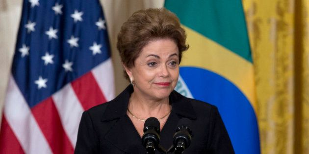 Brazilian President Dilma Rousseff pauses as she speaks during a joint news conference with President...