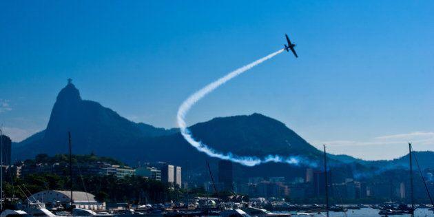 Harbor with plane in flight at Rio de Janeiro