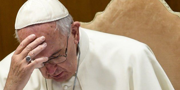 Pope Francis looks on during a morning session of the last day of the Synod on the Family at the Vatican...