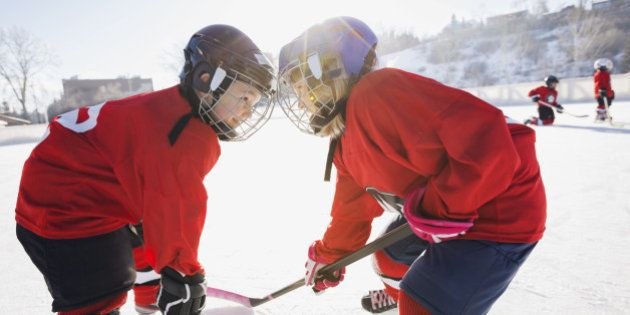 Hockey players facing off on ice