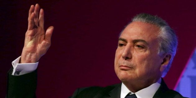 Brazil's Vice President Michel Temer gestures as he attends an Economic Forum in Sao Paulo, Brazil, August...