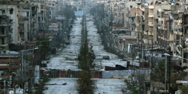 A general view shows a damaged street with sandbags used as barriers in Aleppo's Saif al-Dawla district,...