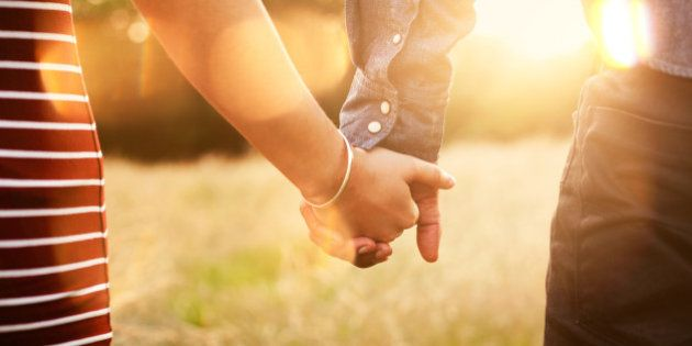 Young couple holding hands with