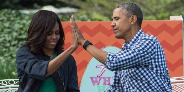 US President Barack Obama and First Lady Michelle Obama high five each other after reading Maurice Sendak's...
