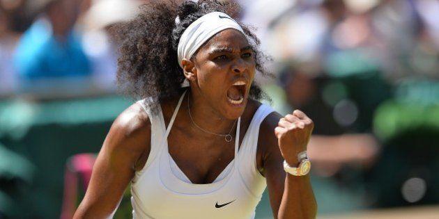 US player Serena Williams celebrates winning the first set against Spain's Garbine Muguruza during the...