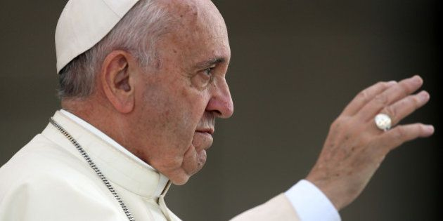 Pope Francis waves as he arrives at Saint Faustina's chapel at the Sanctuary of Divine Mercy in Lagiewniki...