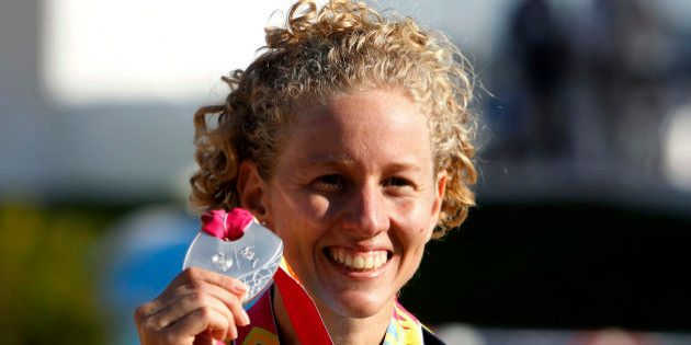 Brazil's Yane Marques smiles with her silver medal after coming in second at the women's Modern Pentathlon...