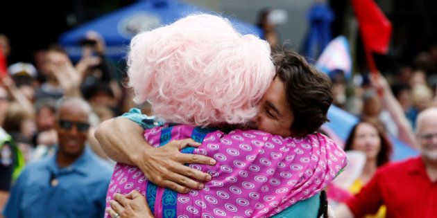 Canada's Prime Minister Justin Trudeau hugs a supporter while walking in the Vancouver Pride Parade in...