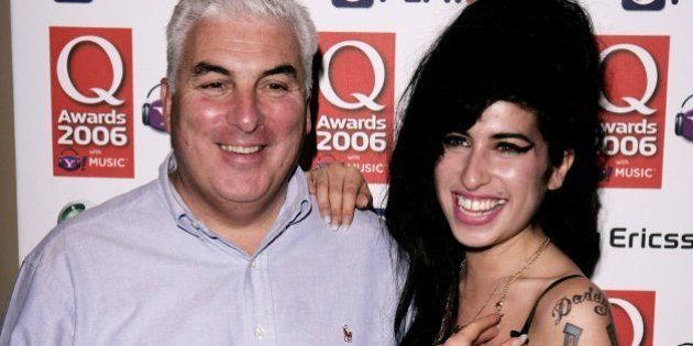 LONDON - OCTOBER 30: Singer Amy Winehouse and her father Mitch pose in the awards room at the Q Awards...