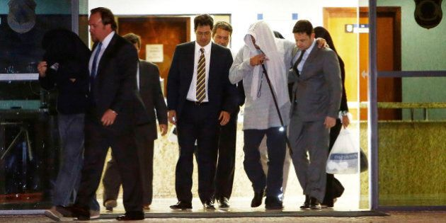 Othon Zanoide (2nd R), director of industrial company Queiroz Galvao SA, leaves the Federal Police after...