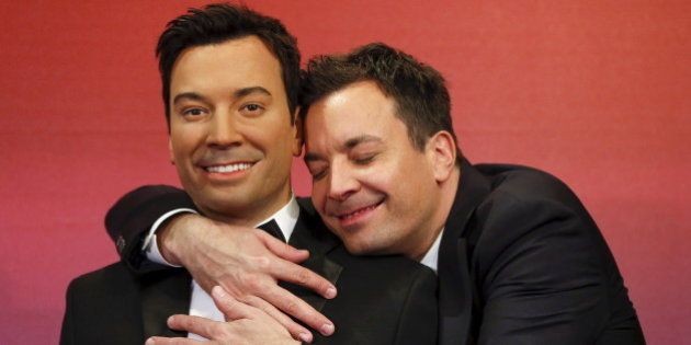 TV host Jimmy Fallon poses with his wax figures at Madame Tussauds museum in the Manhattan borough of...