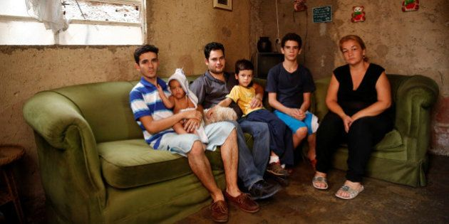 Yunni Perez (R) poses for a picture next to her relatives (L-R) Carlos Acosta, Adrian Gonzalez, Luis...