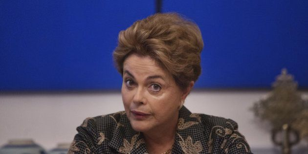 Dilma Rousseff, Brazil's president, speaks during a meeting with journalists at the residence of the...