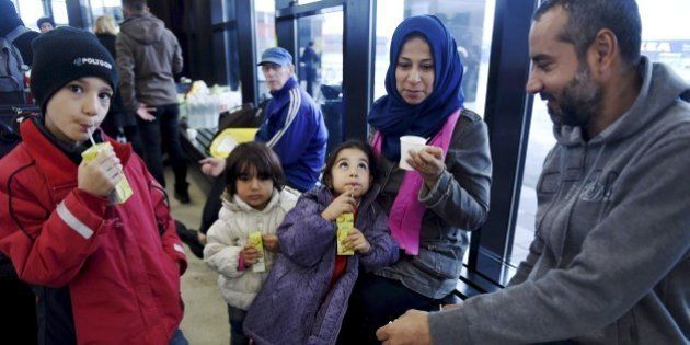 Members of an Iraqi refugee family wait for getting into a refugee reception centre in Tornio, northwestern...