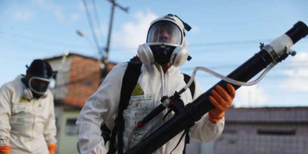 RECIFE, BRAZIL - JANUARY 28: Health workers fumigate in an attempt to eradicate the mosquito which transmits...
