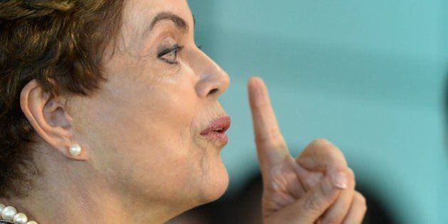 Brazil's President Dilma Rousseff speaks to journalists after visiting the National Center for Coordination...