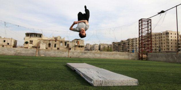 Syrian gymnast Ahmad al-Sawas practises in the rebel-held Bustan al-Qasr neighbourhood of Aleppo, Syria...