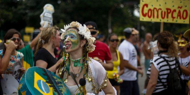 A 'bloco da rua' or street carnival band protests corruption under the theme 'Lava Jato' or Car Wash...