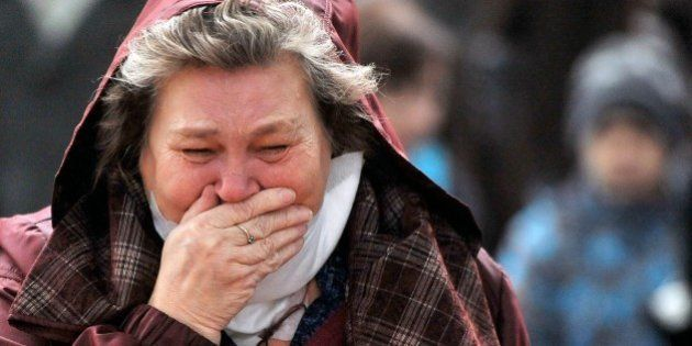 A woman cries as she pays respect at Pulkovo international airport outside Saint Petersburg on November...