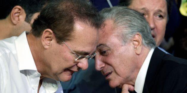 Brazilian Vice President Michel Temer (R) speaks with Senate President Renan Calheiros during the Brazilian...