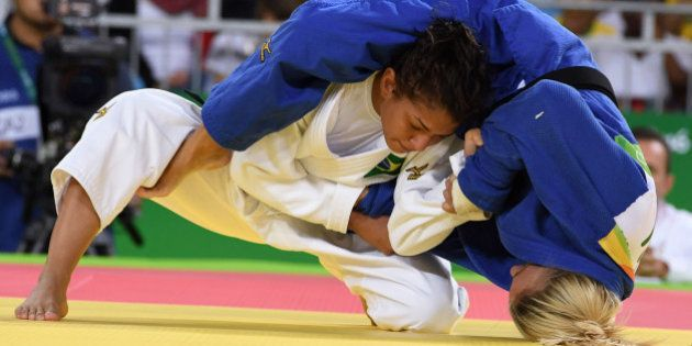 Brazil's Sarah Menezes (white) competes with Belgium's Charline Van Snick during their women's -48kg...