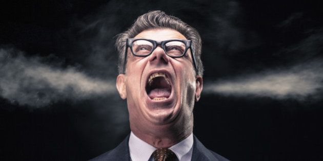 A stressed and upset businessman with grunge glasses is shouting while two steam jets go out from his ears.