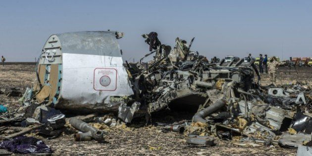 Debris of the A321 Russian airliner lie on the ground a day after the plane crashed in Wadi al-Zolomat,...
