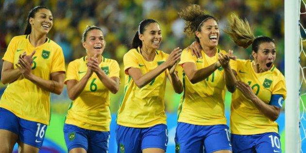 RIO DE JANEIRO, BRAZIL - AUGUST 06: Cristiane of Brazil celebrates her goal with her teammates during...