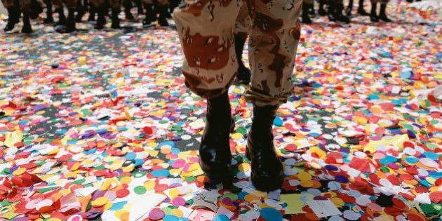 Solider walking in confetti after