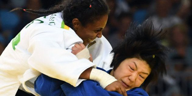 Brazil's Erika Miranda (white) competes with Japan's Misato Nakamura during their women's -52kg judo...