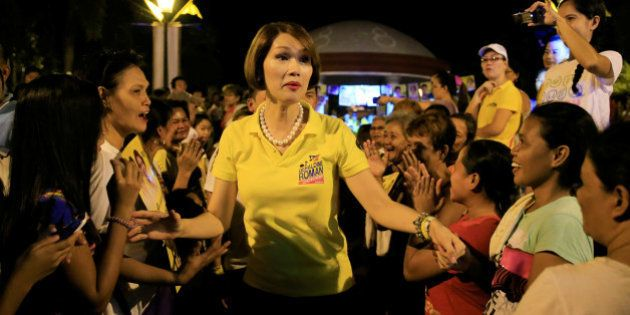 Geraldine Roman, a transgender congressional candidate, (C) is greeted by her supporters during
