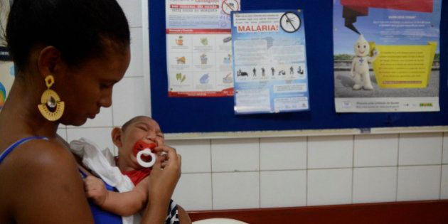 RECIFE, BRAZIL - FEBRUARY 01: João Heitor baby born with microcephaly is held by his mother Gabrielly...