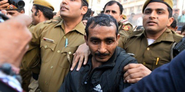 Indian police escort Uber taxi driver and accused rapist Shiv Kumar Yadav (C) following his court appearance...