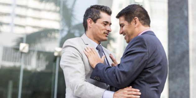 Mature businessmen gay couple