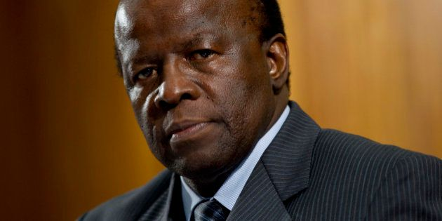 Judge Joaquim Barbosa poses for photos during an interview with Reuters at his office in the Supreme...