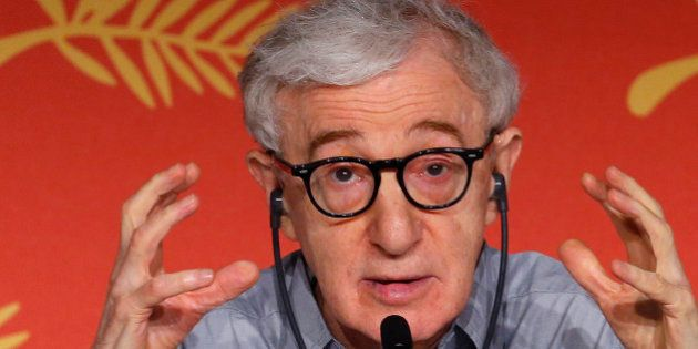 Director Woody Allen gestures as he attends a news conference for the