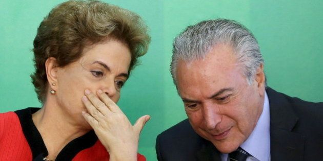 Brazil's President Dilma Rousseff (L) talks to Vice President Michel Temer at the Planalto Palace in...