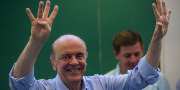 Jose Serra, the mayoral candidate of the Brazilian Social Democracy Party (PSDB), poses after casting...