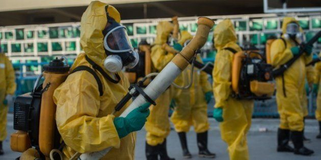 Municipal agents spray anti Zika mosquitos chimical product at the sambadrome in Rio de Janeiro, on January...