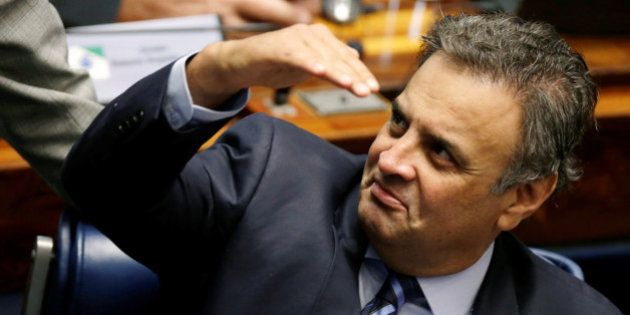 Senator Aecio Neves gestures during the session for debates for the voting of the impeachment of President...