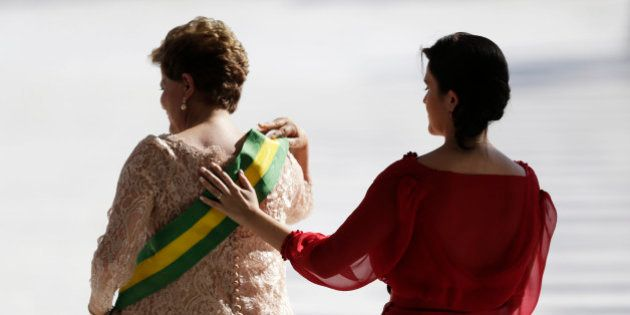 Paula places her hand on the back of her mother, Brazil's President Dilma Rousseff, after Rousseff received...