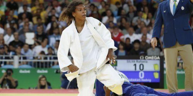 Brazil's Rafaela Silva (white) competes with Hungary's Hedvig Karakas during their women's -57kg judo...
