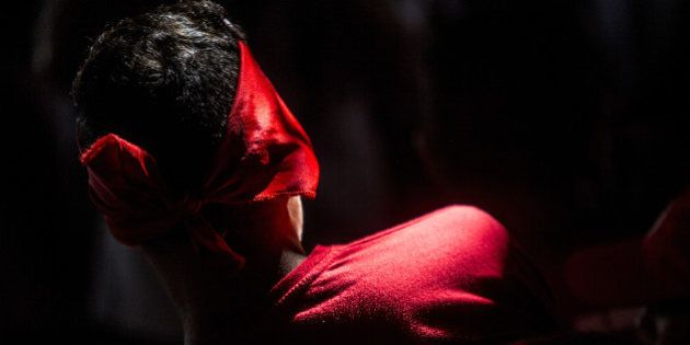 A protester wearing red, the color of the ruling Worker's Party (PT), waits for a rally with Luiz Inacio...