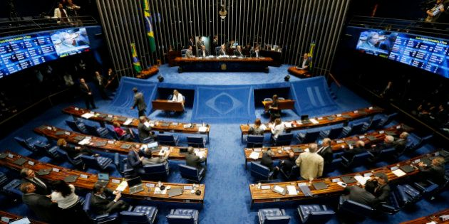BRASILIA, BRAZIL - MAY 11: Lawmakers gather during a special session in the Brazilian Senate to vote...