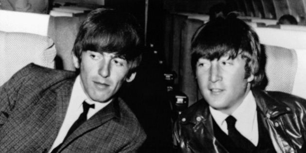FILE - In this May 25, 1964 file photo, then Beatles George Harrison, left, and John Lennon, are seen...