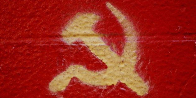 Crossed hammer and sickle painted on wall,