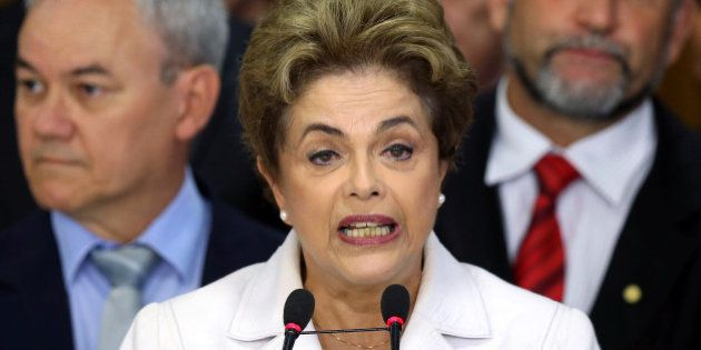 Suspended Brazilian President Dilma Rousseff addresses the audience after the Brazilian Senate voted...