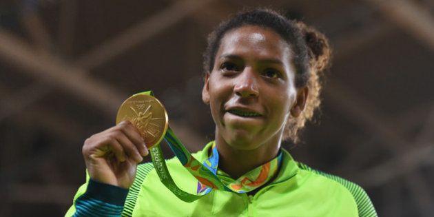 RIO DE JANEIRO, BRAZIL - AUGUST 08: Rafaela Silva of Brazil celebrates after winning the gold medal in...