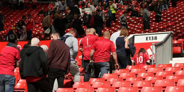 MANCHESTER, ENGLAND - MAY 15: Fans are evacuated from the stands following a security alert and subsequent...
