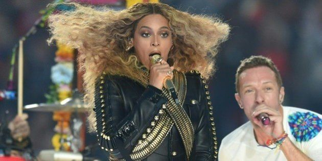 Beyonce and Chris Martin perform during Super Bowl 50 between the Carolina Panthers and the Denver Broncos...